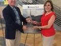 Principal Yvette Soliz presents the Ambassador Award to FBC Buda on behalf of Hays CISD and Camino Real Elementary